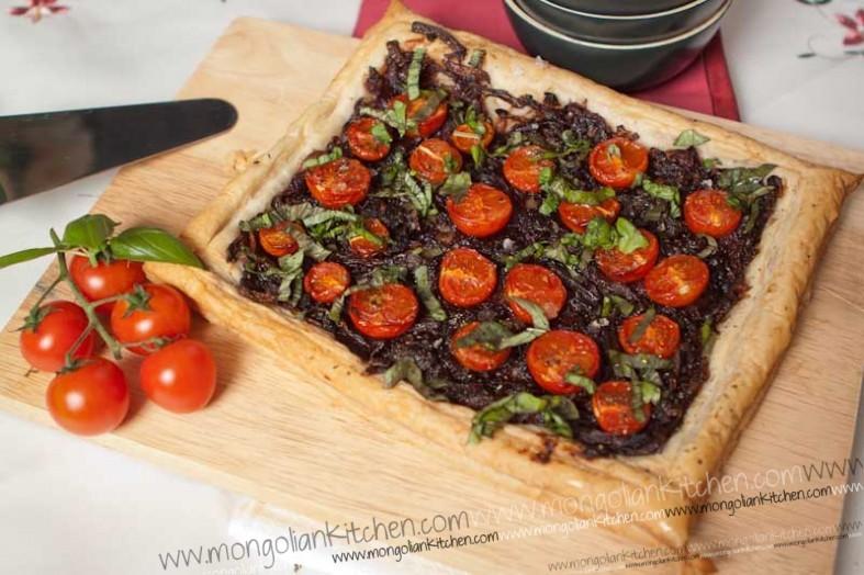 Delicious Caramelised onion and tomato tart recipe