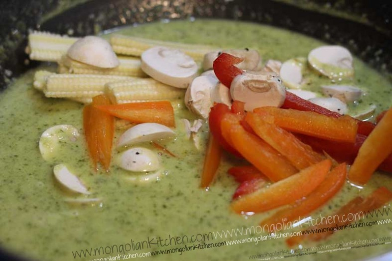 Add the vegetables to the Thai Green Curry and Simmer