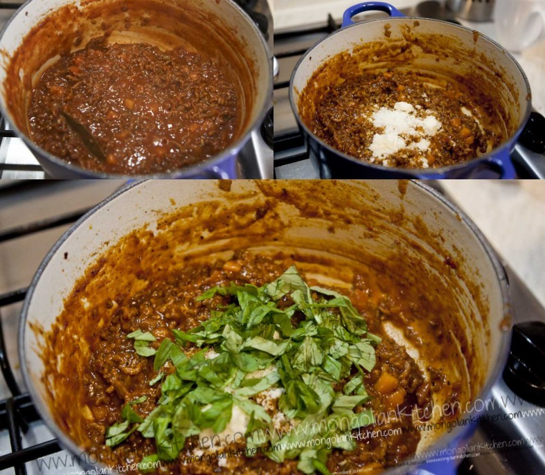 add parmesan and basil to the slow cooked bolognese sauce
